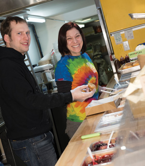 Peter Savani and Brittany Kessler making donuts at the Strip District store.