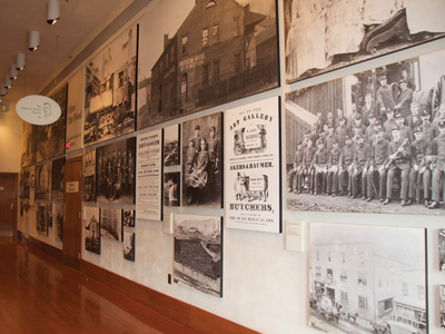 Photo gallery at Johnstown Flood Museum depicting the lively and vibrant community Johnstown was prior to the Flood of 1889.