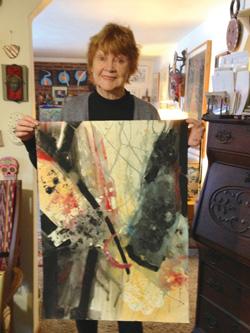 Kathleen Zimbicki holding her abstract painting Dark Matter, 2018.