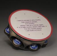 An example of ROY's tiny tambourine jewelry.