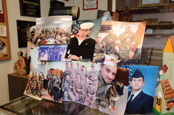 A photographic display of some of the military recipients of donated Nancy B's cookies.