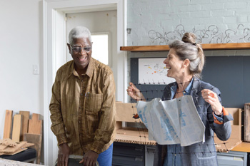 Artist El Anatsui and Carnegie International curator Ingrid Schaffner examine a printing plate destined for the museum's facade.