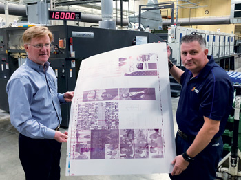 Knepper Press's Ted Ford (CEO, left) and Scott Nock (press room manager) display a typical offset printing plate, of the kind used for the Carnegie  International.
