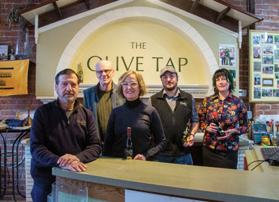 Those who make the Olive Tap the success that it is (left to to right): Hersh Petrocelly, owner, Bob Mostachetti, Karen Jorgensen, owner, Derrick Ledbetter, and Lauren Snyder.