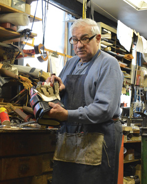 Bucky Palermo in his shoe repair shop (from the estate of Bucky Palermo)